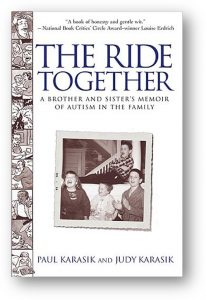 The cover of the book The Ride Together is pictured. It shows a strip of cartoon characters down the side, and an old family snapshot on the front. The authors are Paul and Judy Karasik.