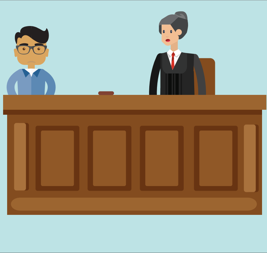 A boy stands behind a desk next to a woman wearing a robe who is a judge.