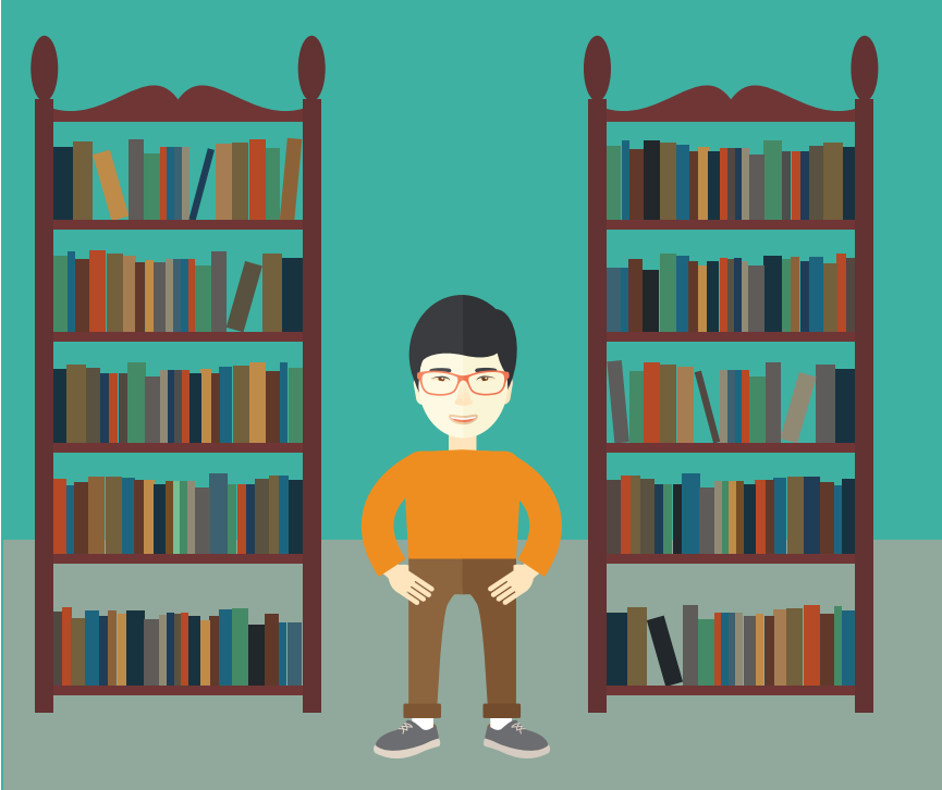 A smiling boy stands between two bookshelves.