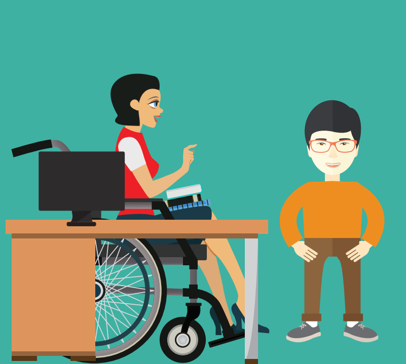 A boy stands to the right of a woman in a wheelchair sitting at a desk with a computer.