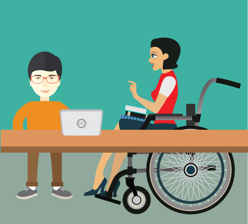 A smiling boy stands behind a desk with a computer next to a woman in a wheelchair.