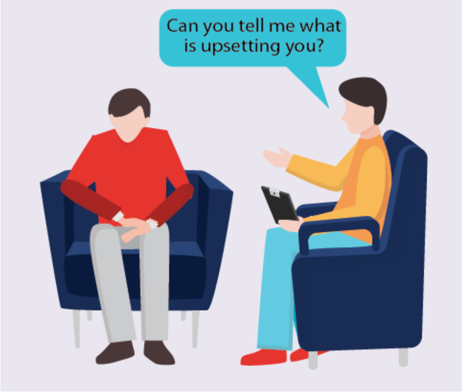 A therapist sits in a chair next to his patient and says,