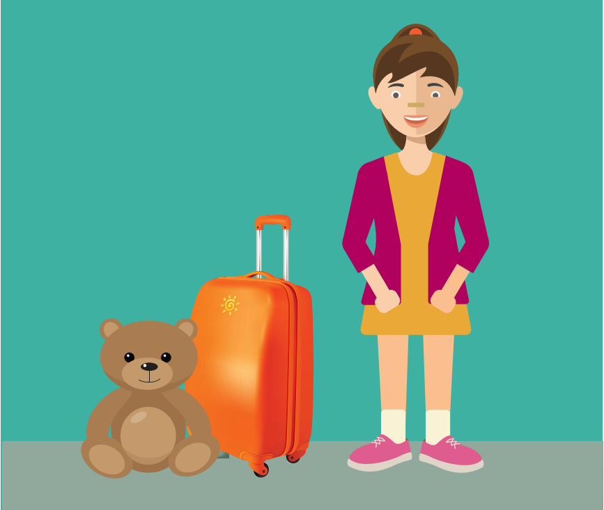 A smiling young girl stands next to the right of a teddy bear and suitcase.