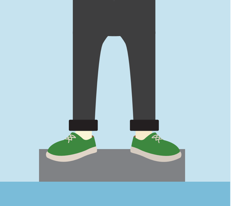 A boy's legs and shoes are shown standing on a scale.