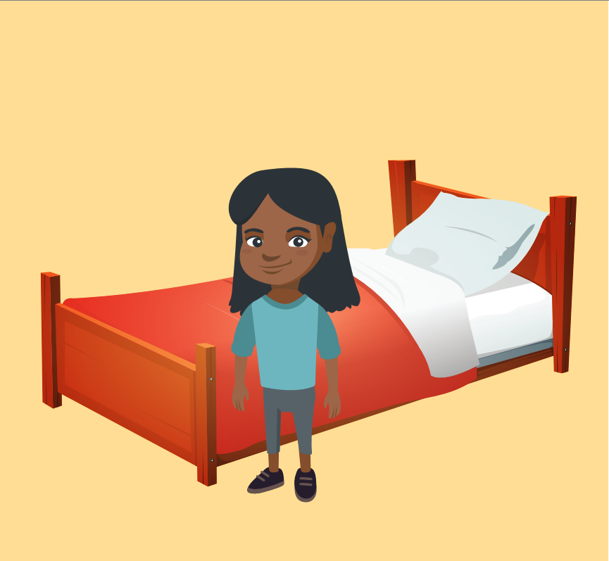 A smiling young girl stands in front of a bed.
