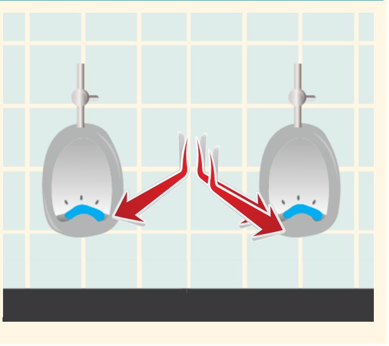 Two urinals shown with blue discs that help them smell better. Red arrows point out the discs at the bottom of the urinals.