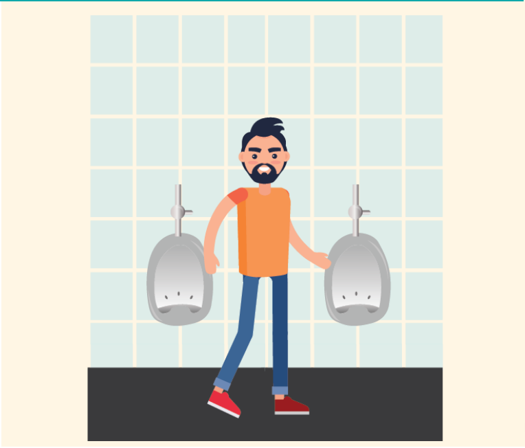 A man stands in a bathroom between two urinals after pulling up his pants.