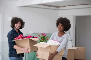 A young man and woman with moving boxes.