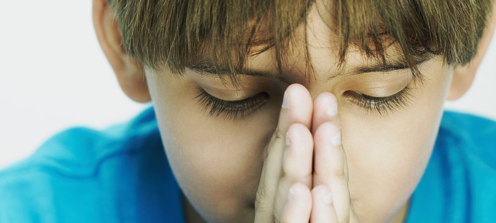 A Little Boy Praying