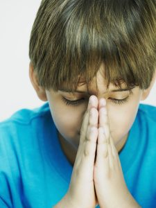 A Little Boy Praying