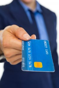 Someone holding a credit card