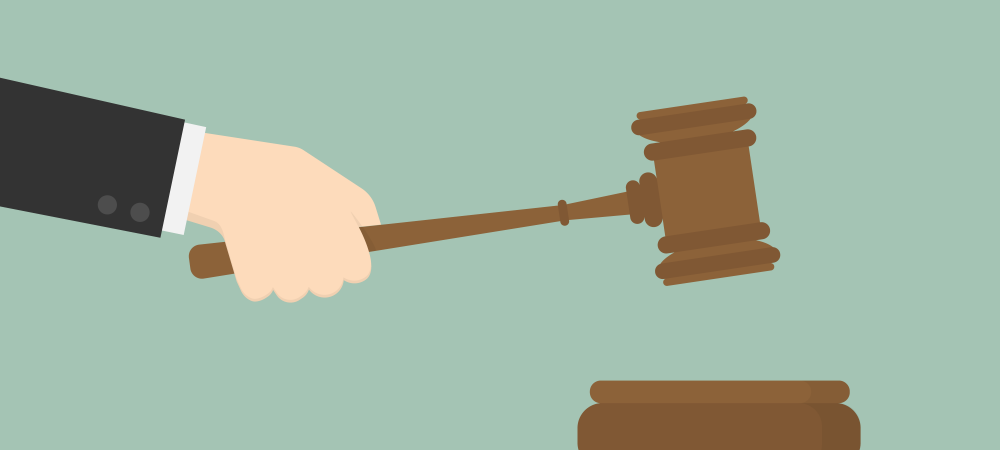 Cartoon rendering of a hand holding a gavel.
