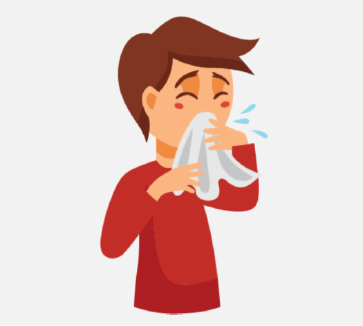 A sick boy coughing into a tissue.