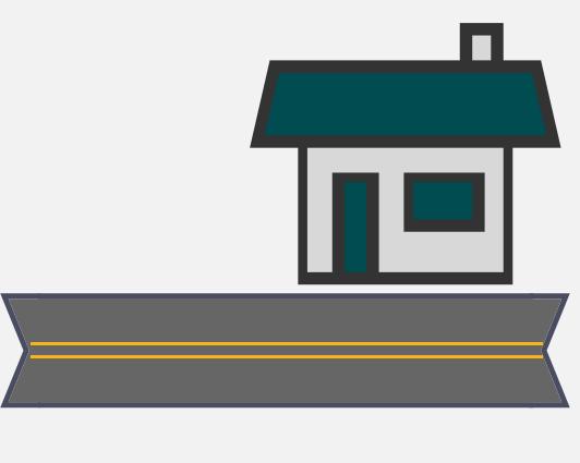 A building alongside a road.