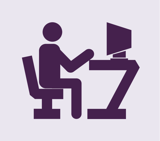 Clip art of a man sitting at a desk with a computer.
