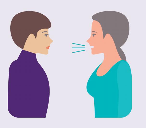 A woman talking to a friend.