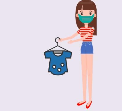 A woman wearing a mask holding a t-shirt.