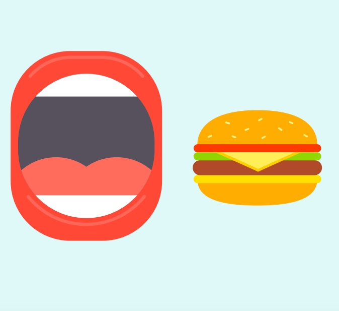A mouth next to a cheeseburger.