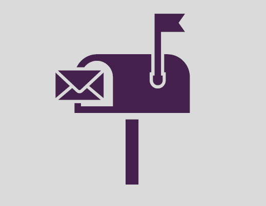 An envelope being put into a mailbox.