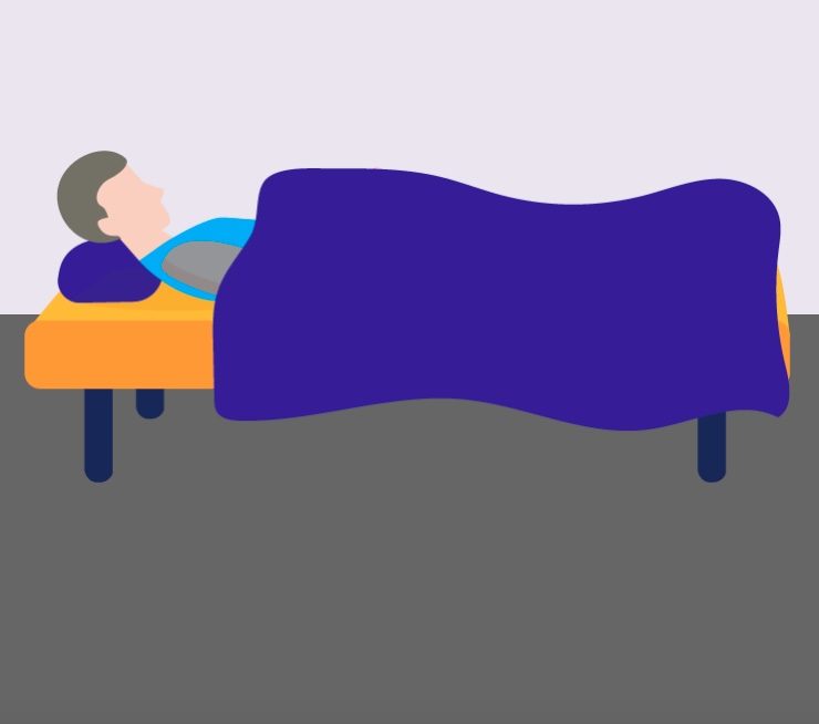 A man sleeping in a bed.