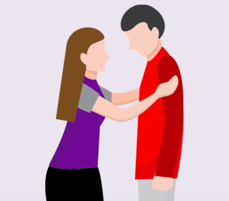 A woman touching the arms of a man.