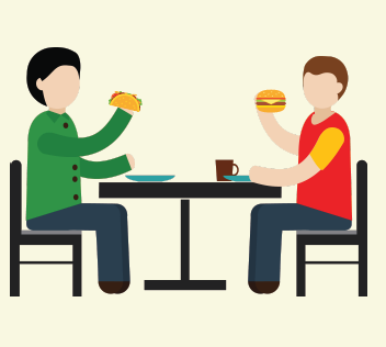 The boy eats his burger and the friend eats his taco