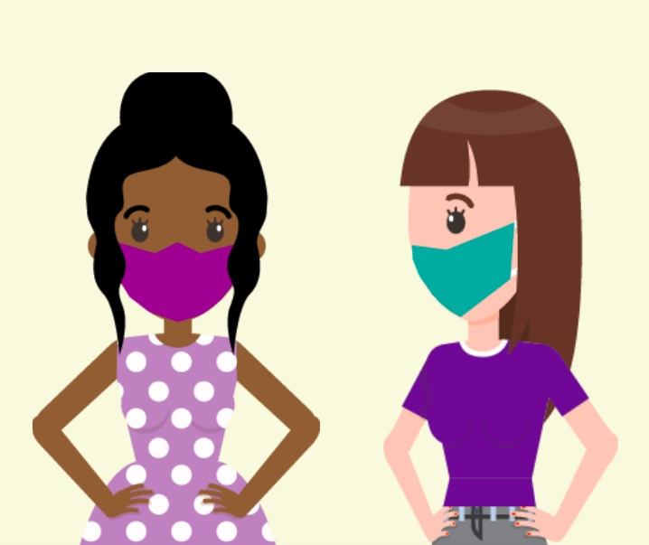 Two women standing next to each other wearing masks.